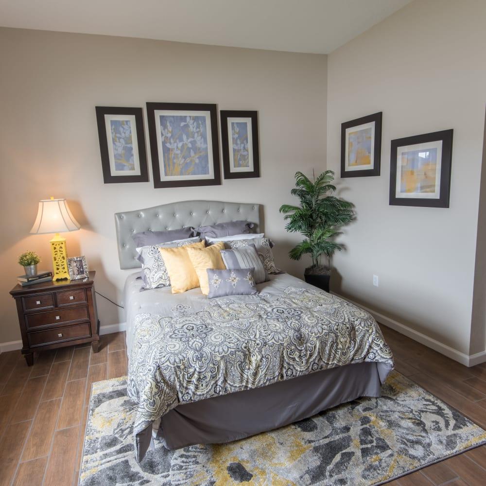 Resident bedroom with wall art at Inspired Living at Bonita Springs in Bonita Springs, Florida