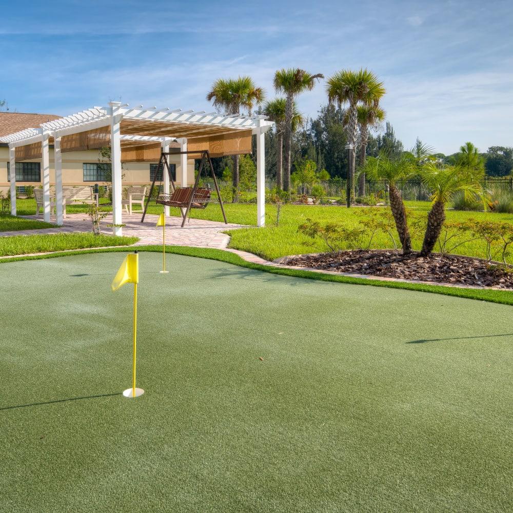 Putting green at Inspired Living Hidden Lakes in Bradenton, Florida.