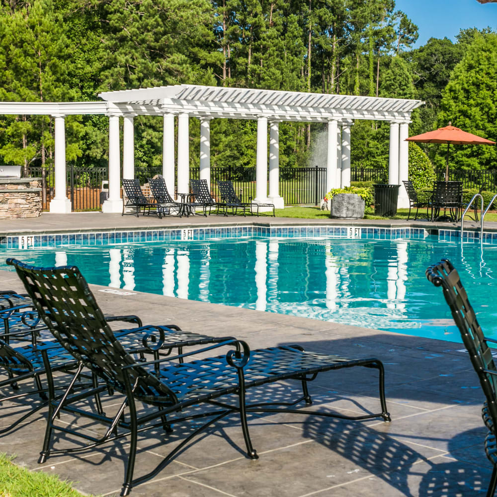 Poolside seating at Bryant at Summerville in Summerville, South Carolina