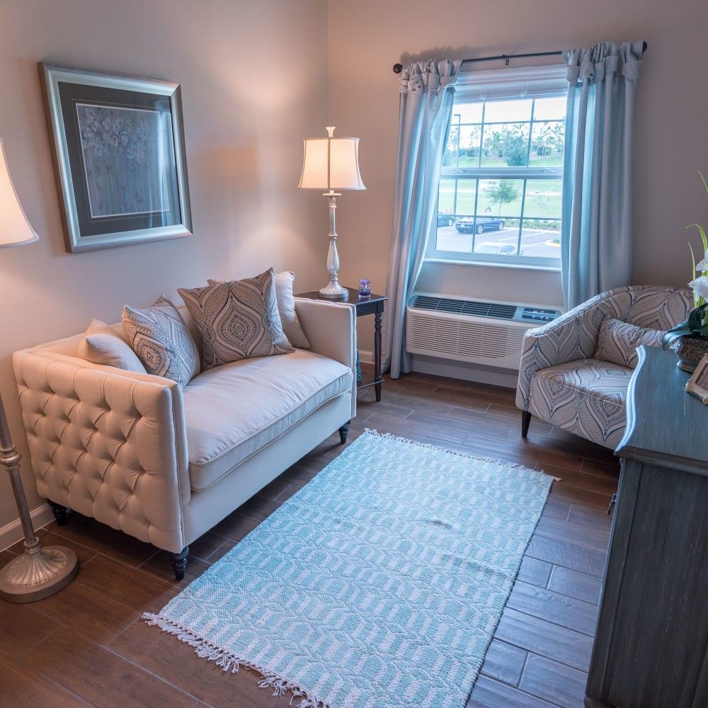Studio apartment living room at Inspired Living at Royal Palm Beach in Royal Palm Beach, Florida