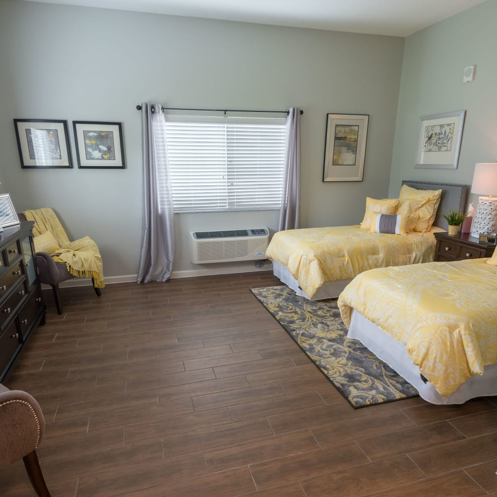 A companion room you will share with another resident at Inspired Living at Royal Palm Beach in Royal Palm Beach, Florida