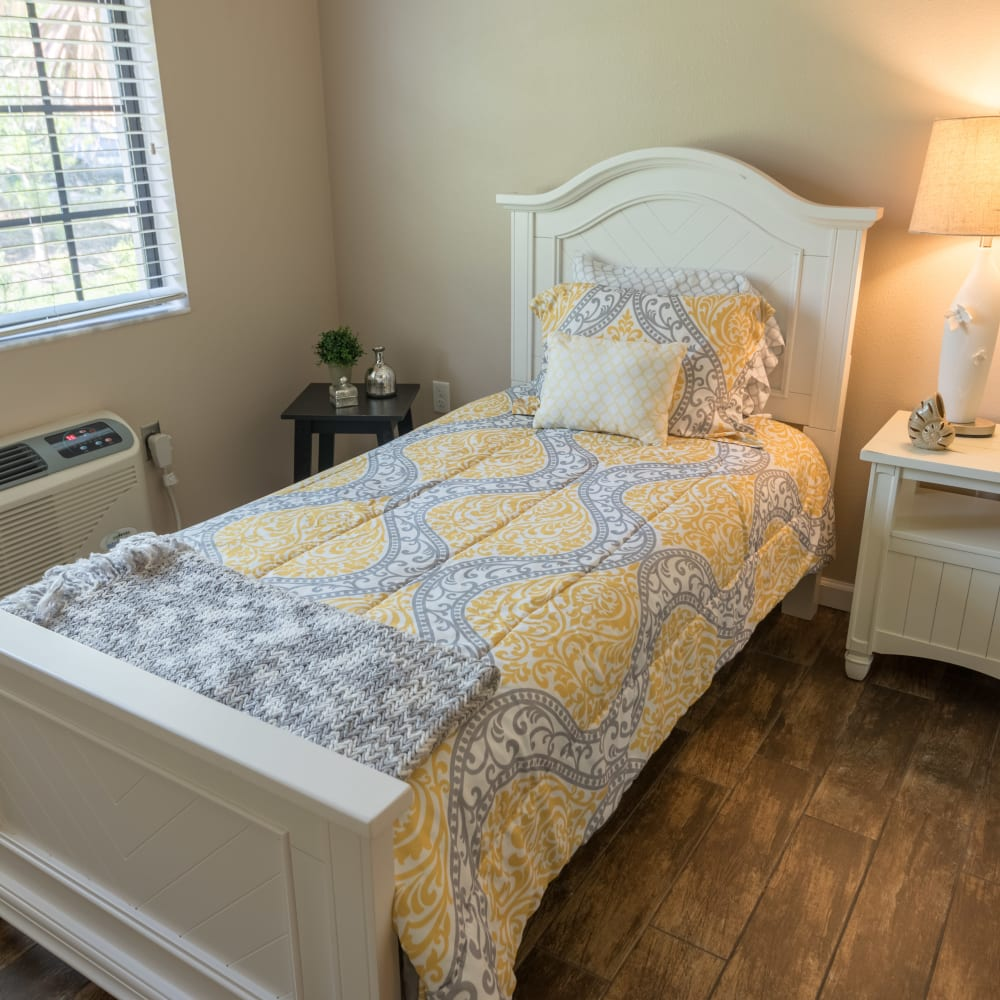 Model bedroom with hardwood flooring at at Inspired Living in St Petersburg, Florida