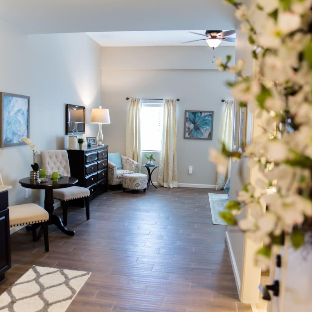 A living area in an apartment at Inspired Living Alpharetta in Alpharetta, Georgia