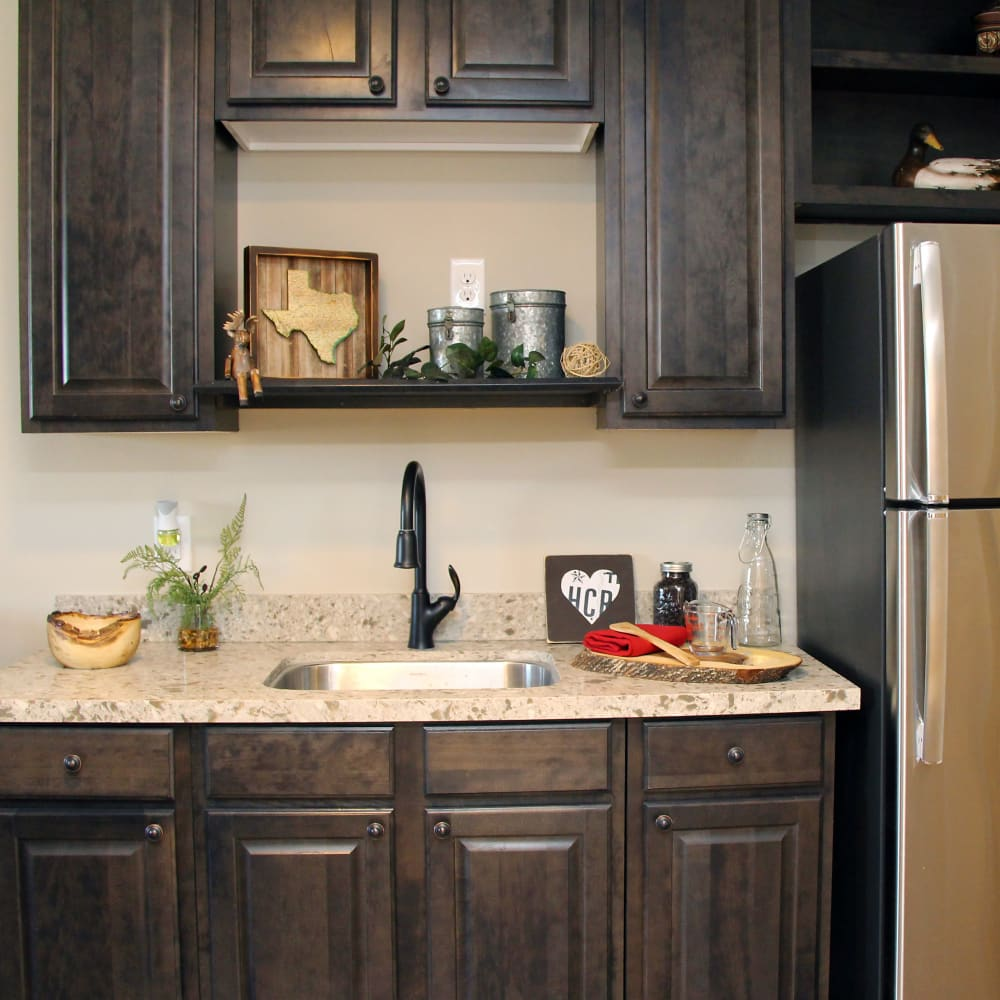 A kitchenette is in some floor plans at Inspired Living Delray Beach in Delray Beach, Florida