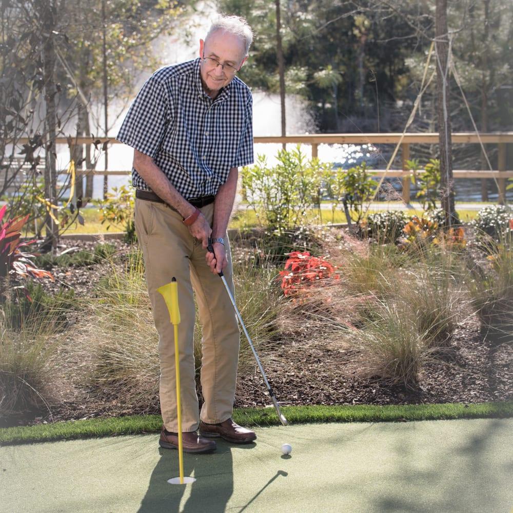 Resident playing golf at Inspired Living Lakewood Ranch in Bradenton, Florida.