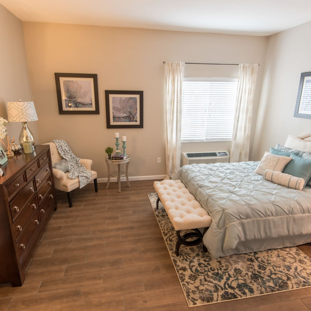 A spacious resident bedroom at Inspired Living in Sun City Center, Florida.