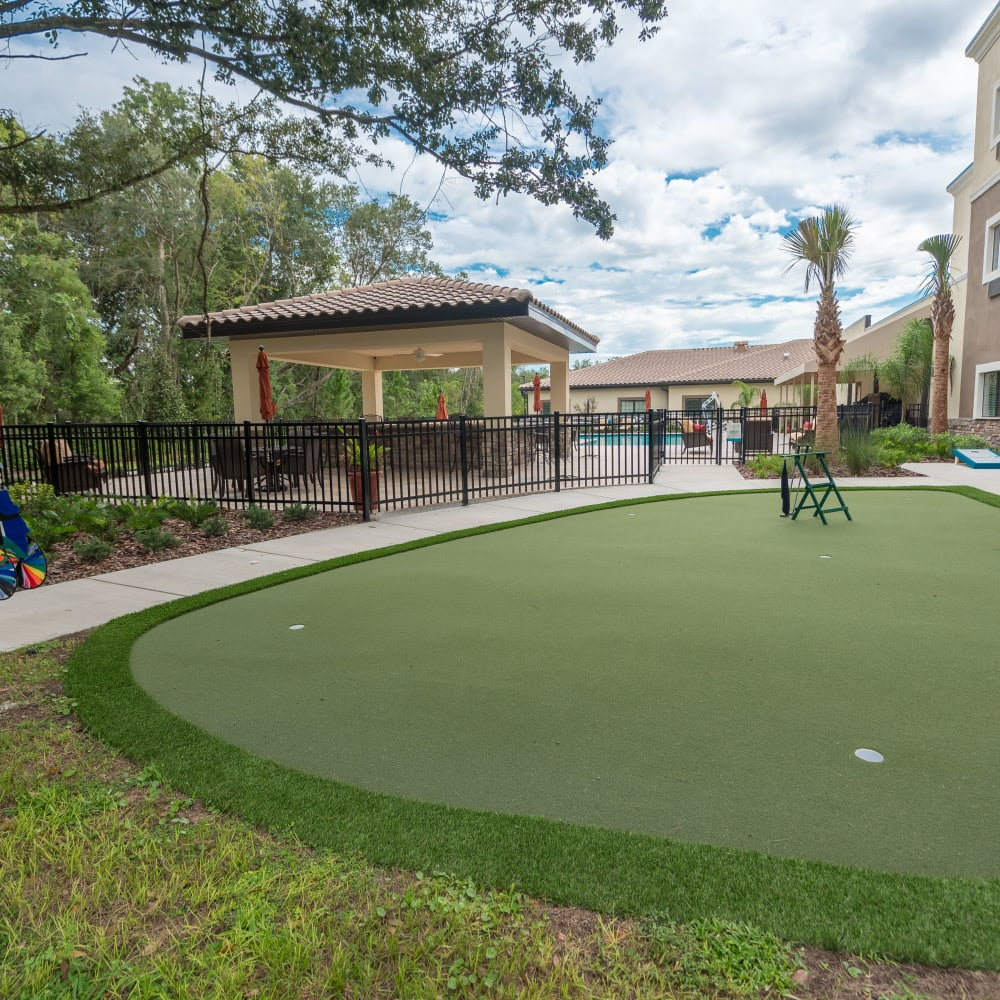 Putting green at Inspired Living Delray Beach in Delray Beach, Florida