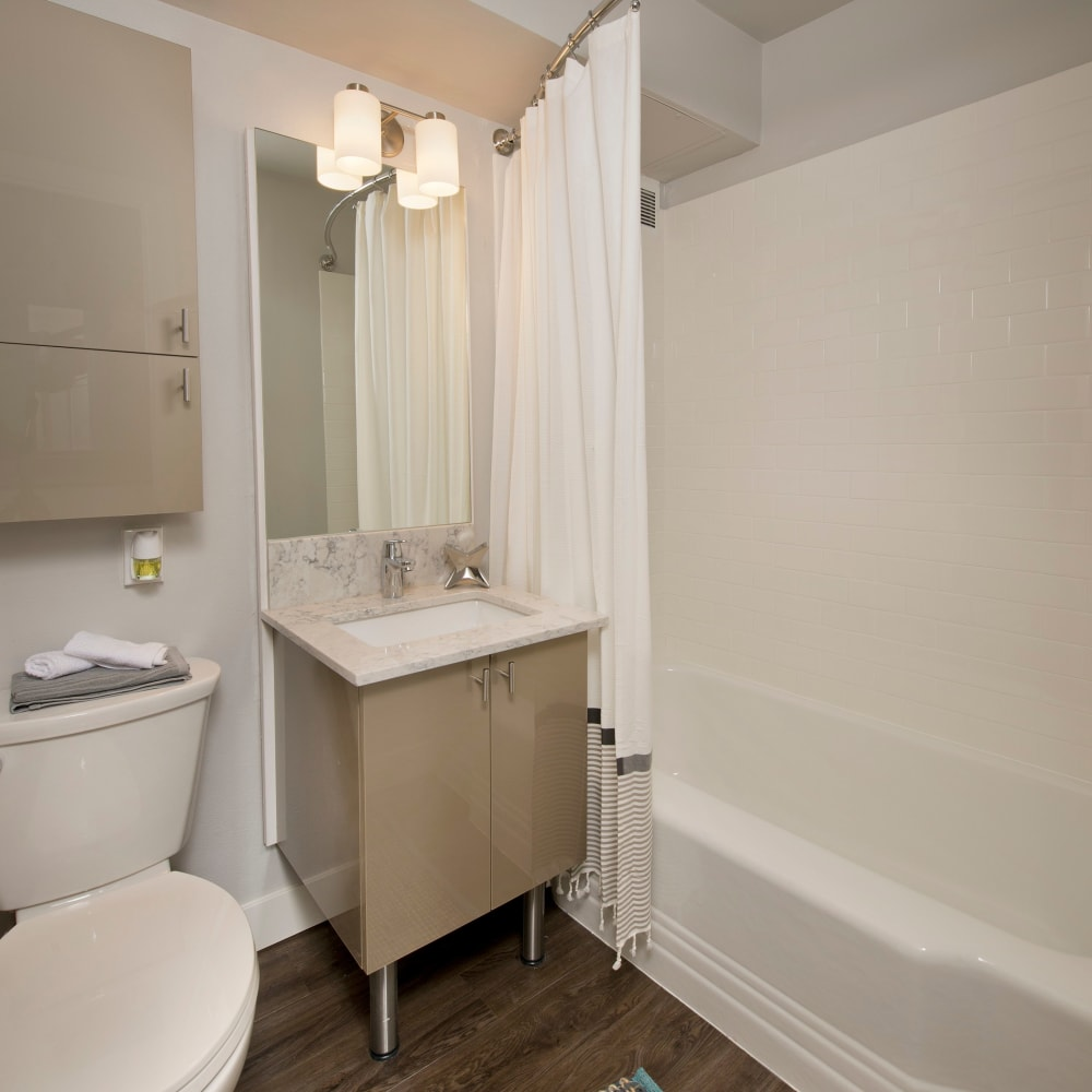 Compact bathroom with a tub at The Mill at First Hill in Seattle, Washington