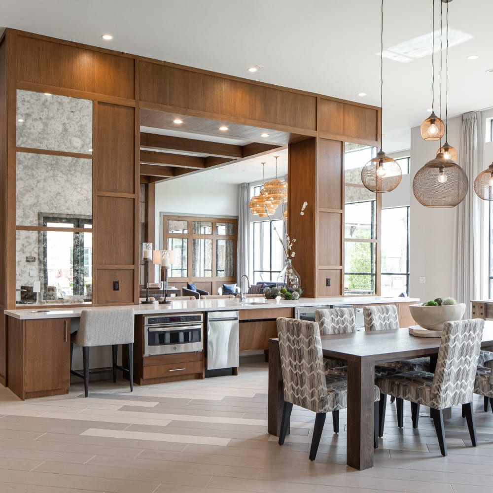 Catering kitchen with gathering table in clubhouse at Opal at Barker Cypress in Houston, Texas