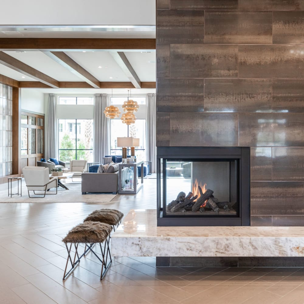 Luxurious resident clubhouse with fireplace at Opal at Barker Cypress in Houston, Texas