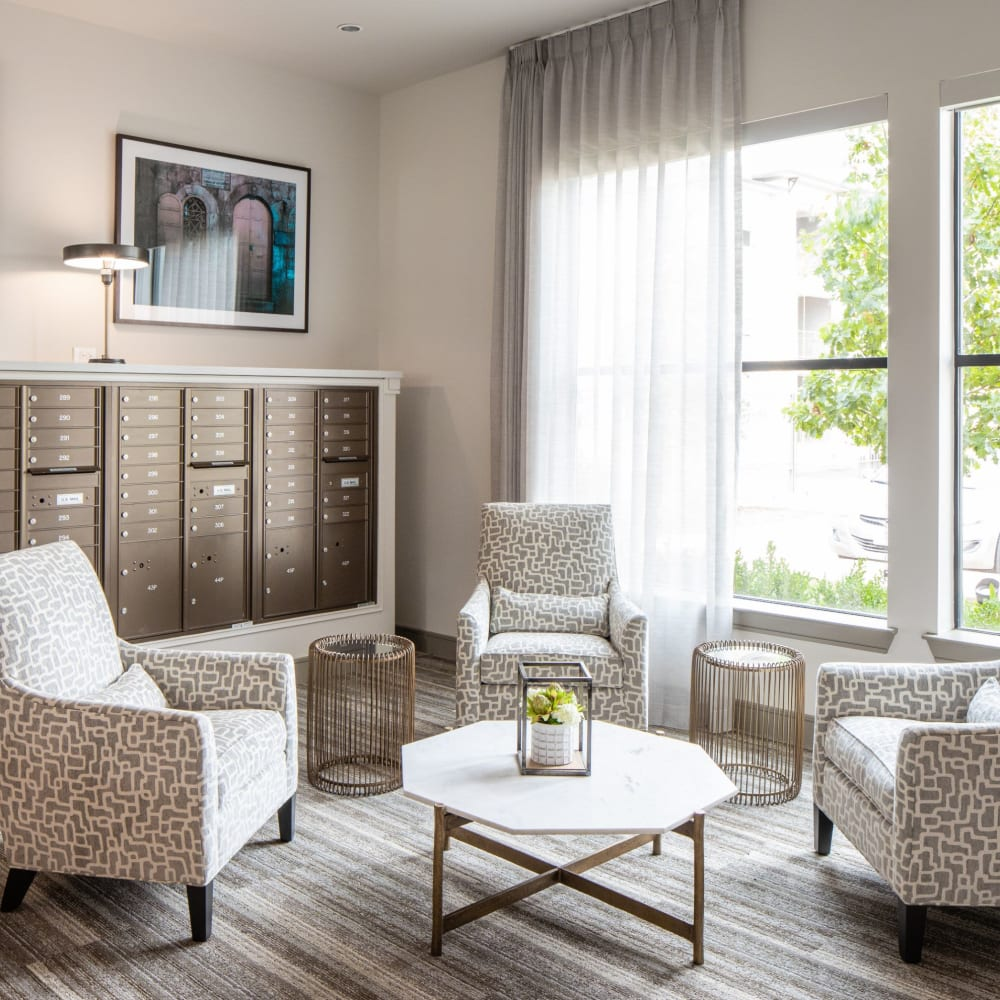 Comfortable seating by parcel lockers at Opal at Barker Cypress in Houston, Texas