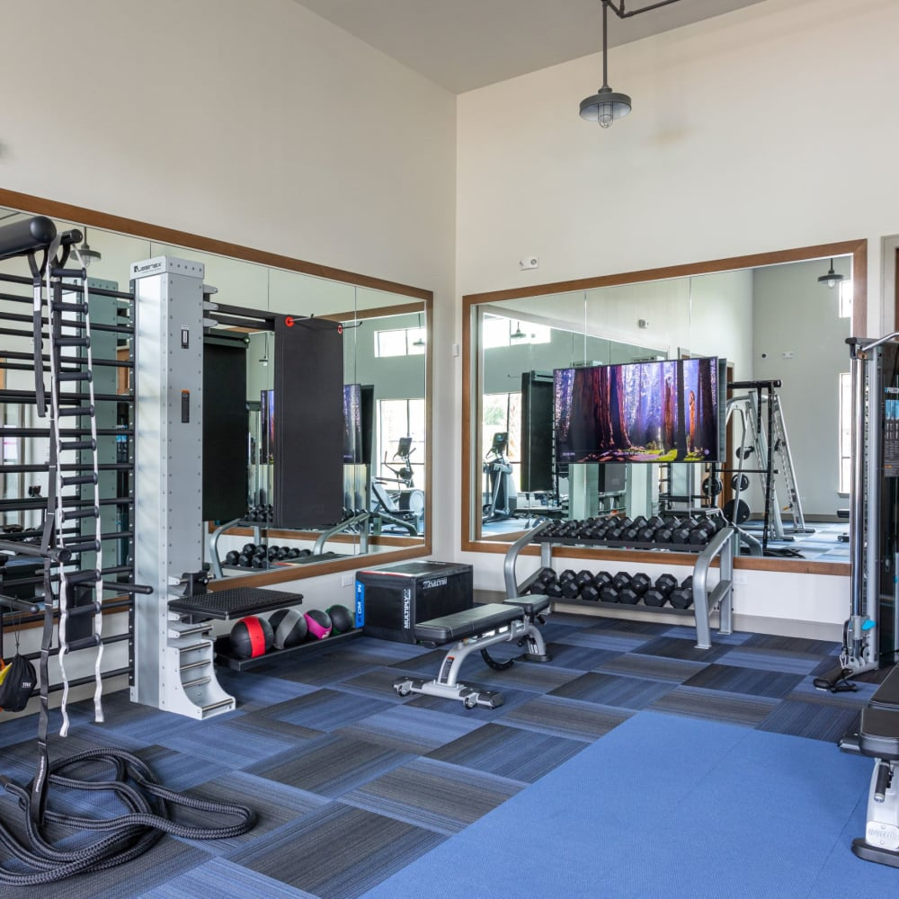 Fitness center and more in the clubhouse at Opal at Barker Cypress in Houston, Texas