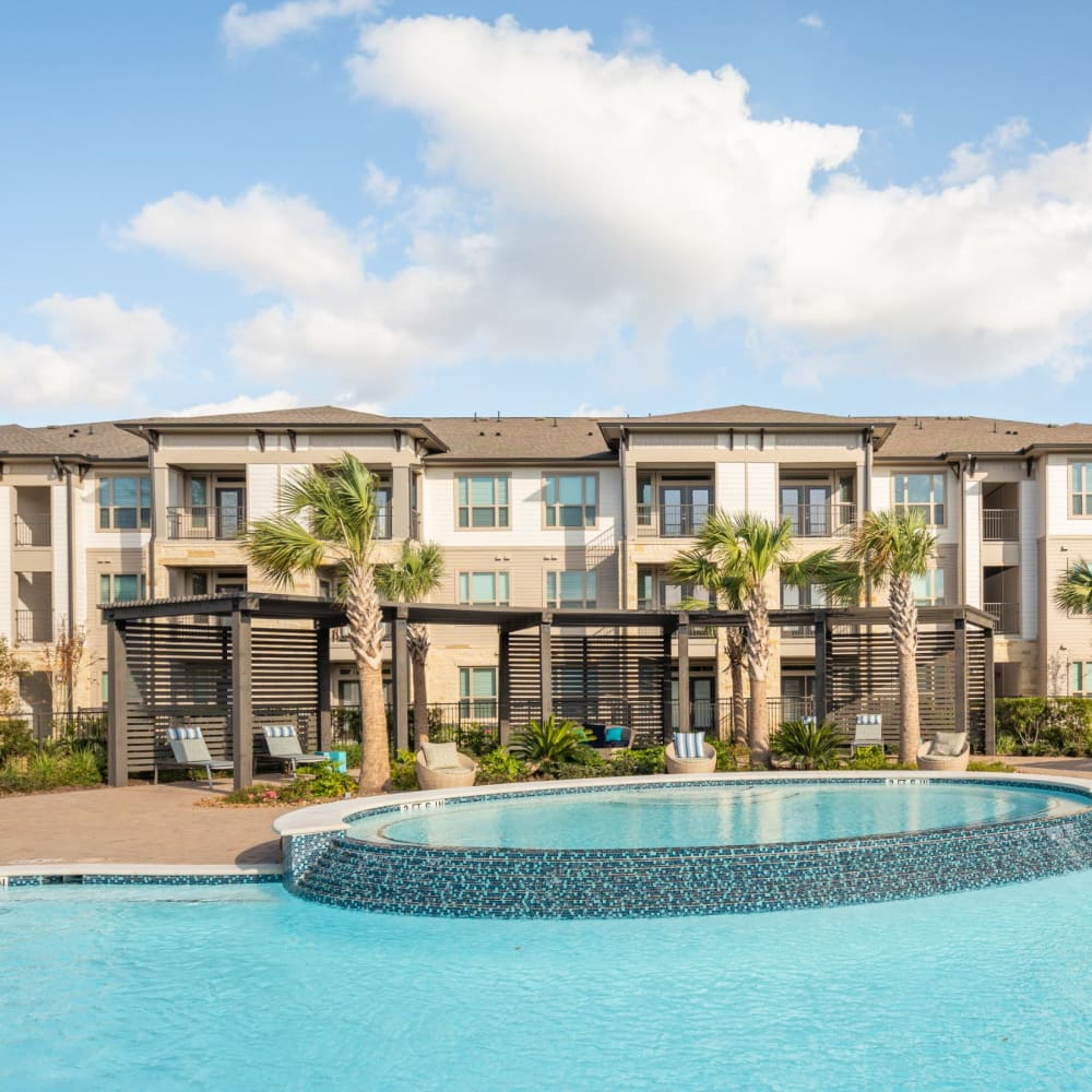 View virtual tour of our swimming pool area at Opal at Barker Cypress in Houston, Texas