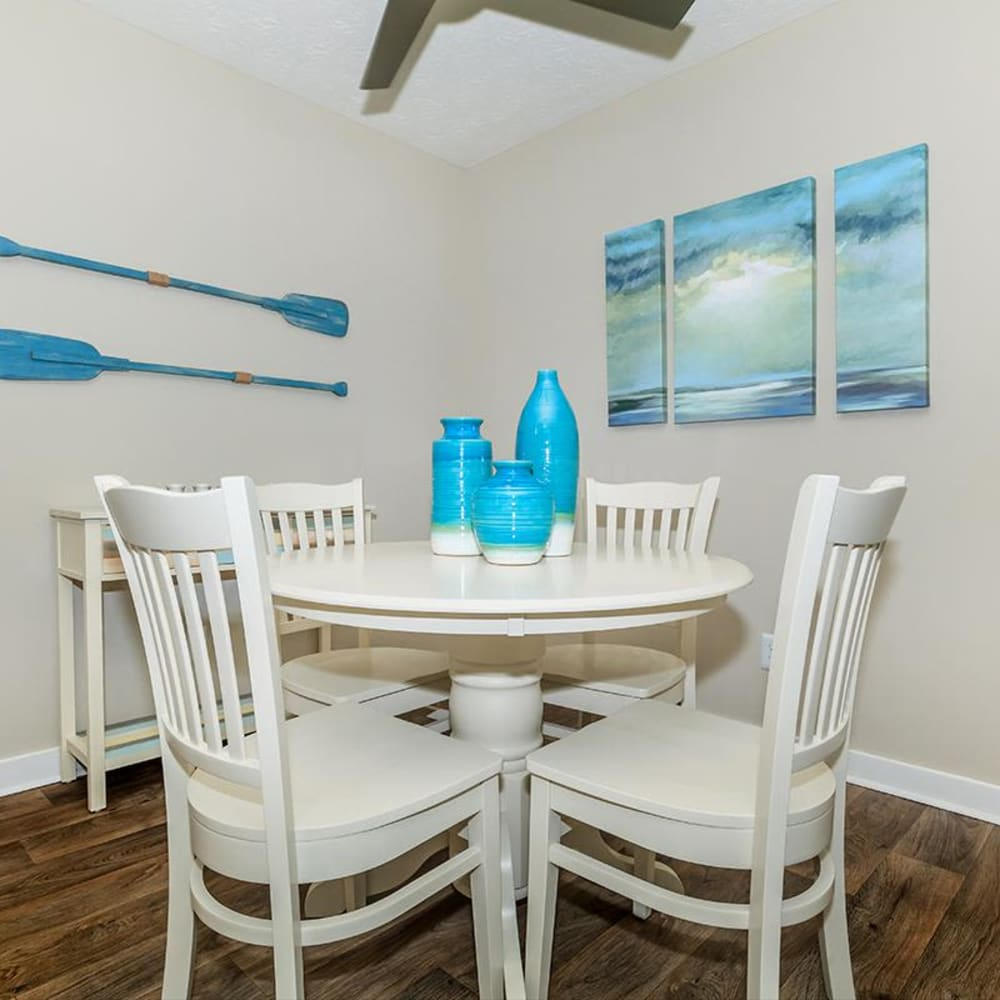Dining nook with a ceiling fan overhead in a model home at The Bentley at Marietta in Marietta, Georgia