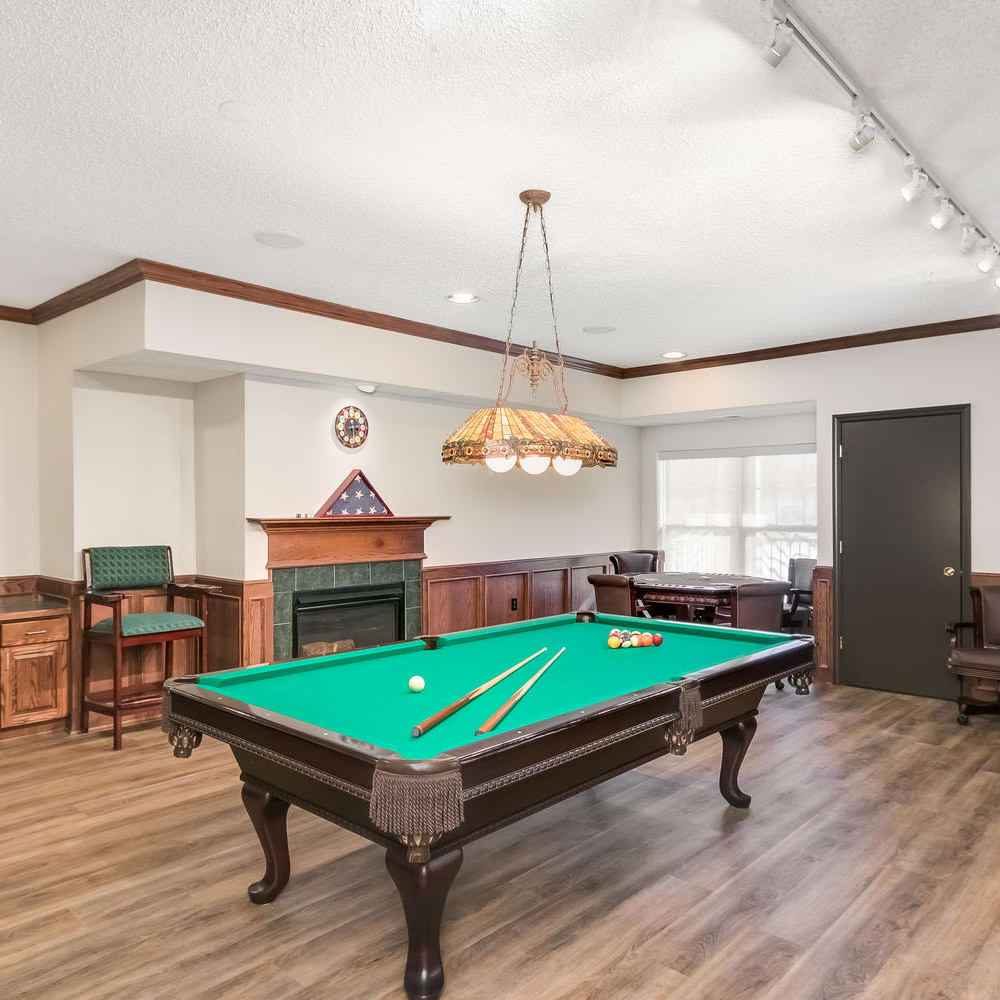 Game room with pool table at Applewood Pointe of Roseville in Roseville, Minnesota