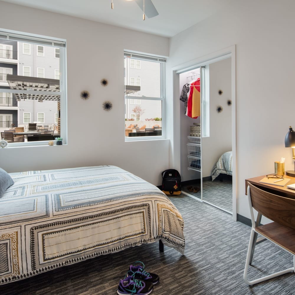 Large bedroom with plenty of closet space at UNCOMMON Athens in Athens, Georgia