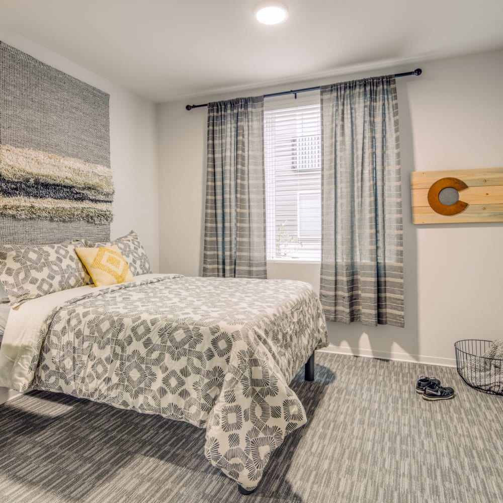 Bright bedroom at UNCOMMON Fort Collins in Fort Collins, Colorado