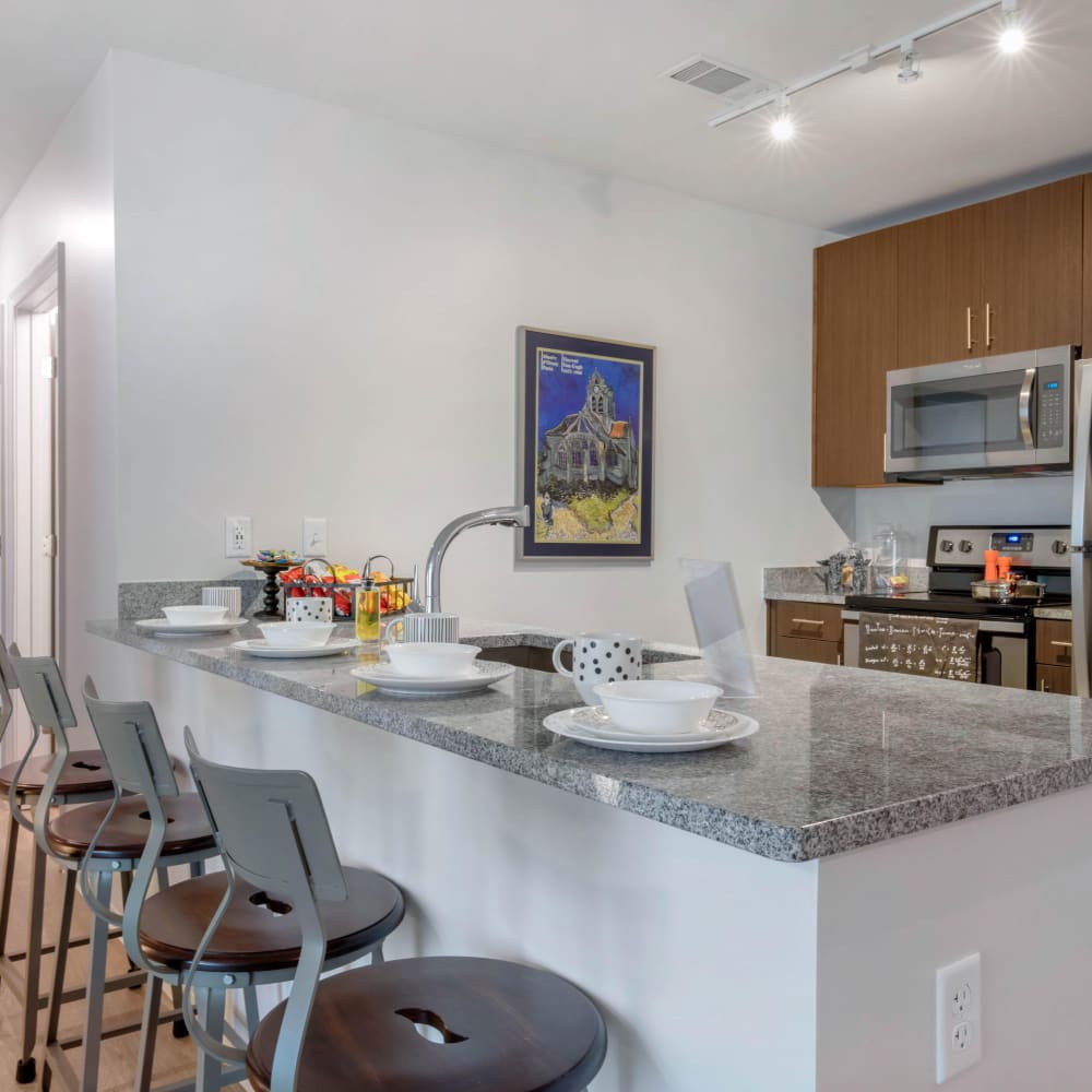 Modern kitchen with stainless steel appliances at UNCOMMON Oxford in Oxford, Mississippi