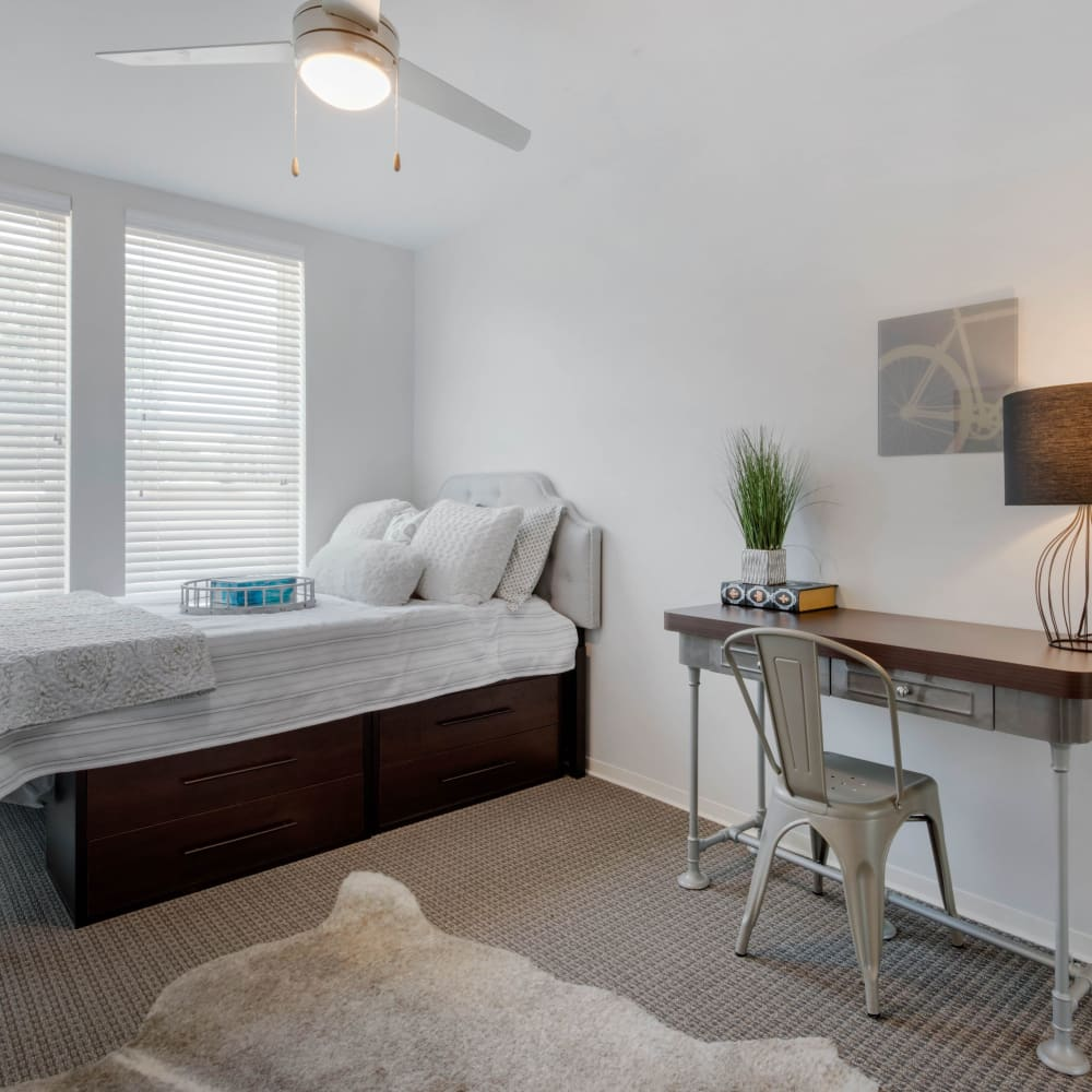 Bedroom with a ceiling fan at UNCOMMON Oxford in Oxford, Mississippi