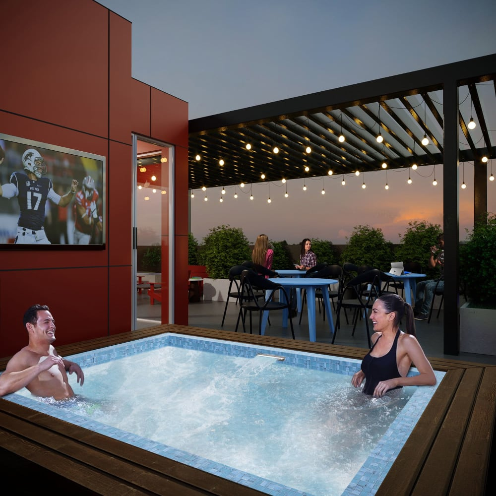 Residents relaxing in the hot tub at UNCOMMON Reno in Reno, Nevada