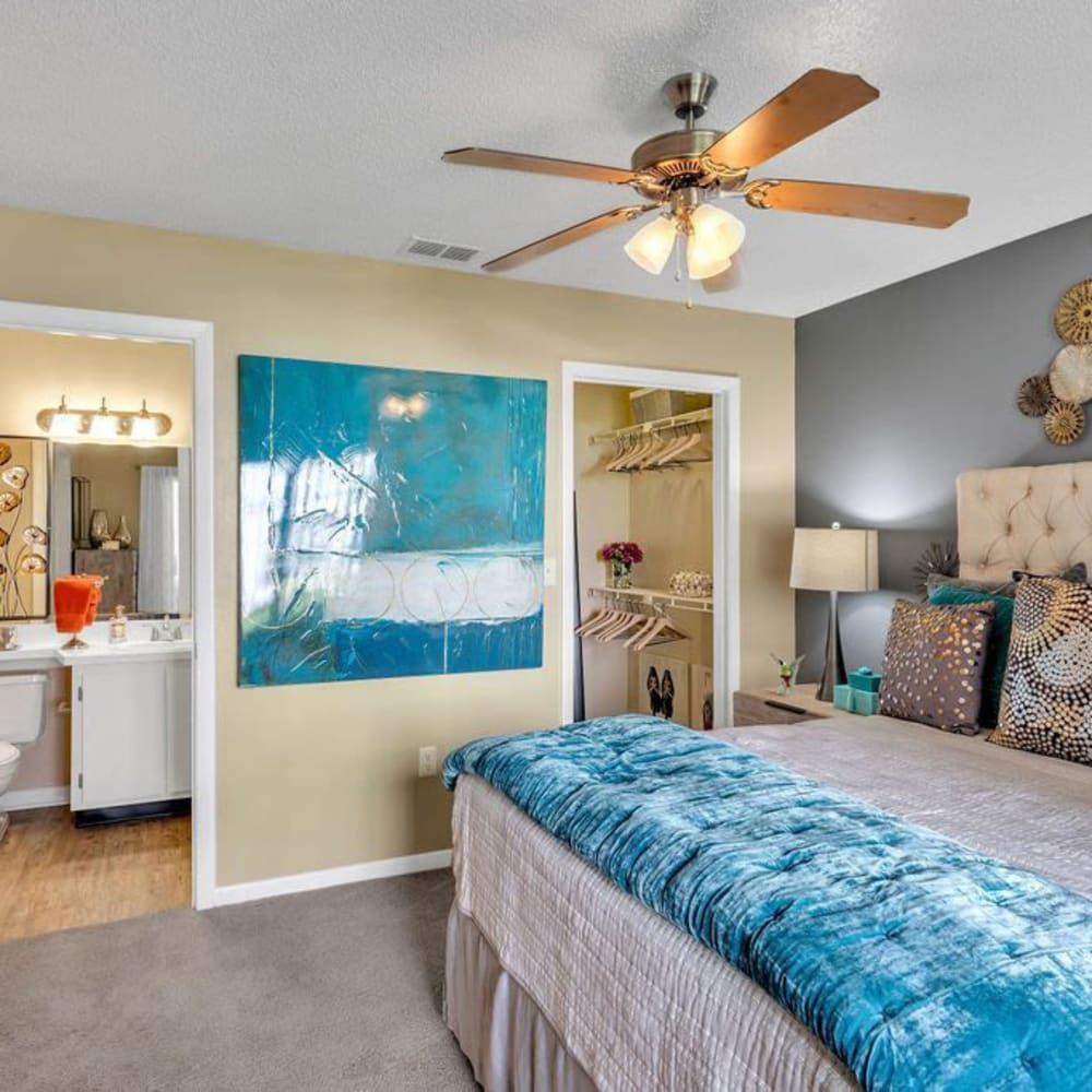 A comfy apartment bedroom at The Braxton in Palm Bay, Florida