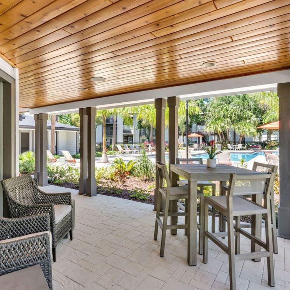 A patio area with seating at The Braxton in Palm Bay, Florida