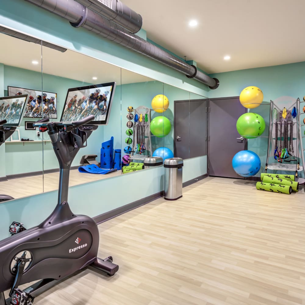 Yoga studio with spin bikes at LATITUDE at Kent in Kent, Ohio
