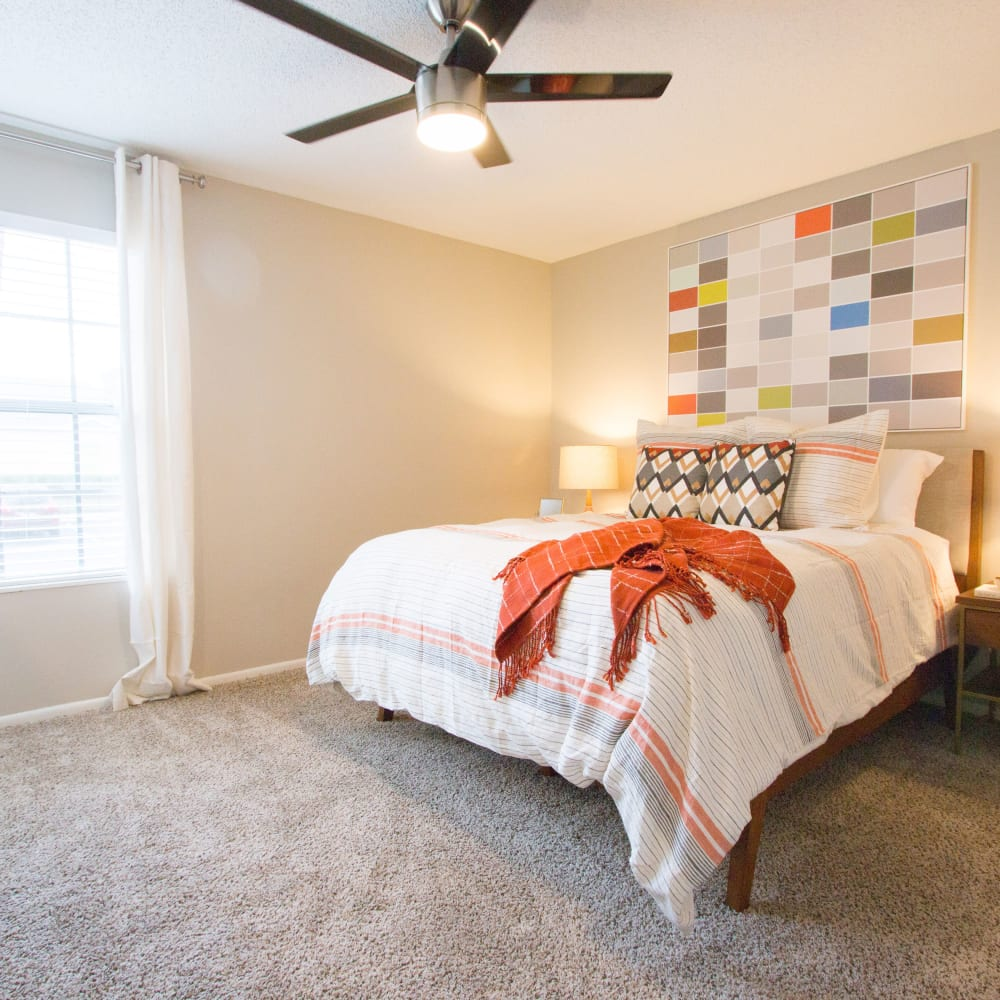 A furnished apartment bedroom at Fairways at Feather Sound in Clearwater, FL
