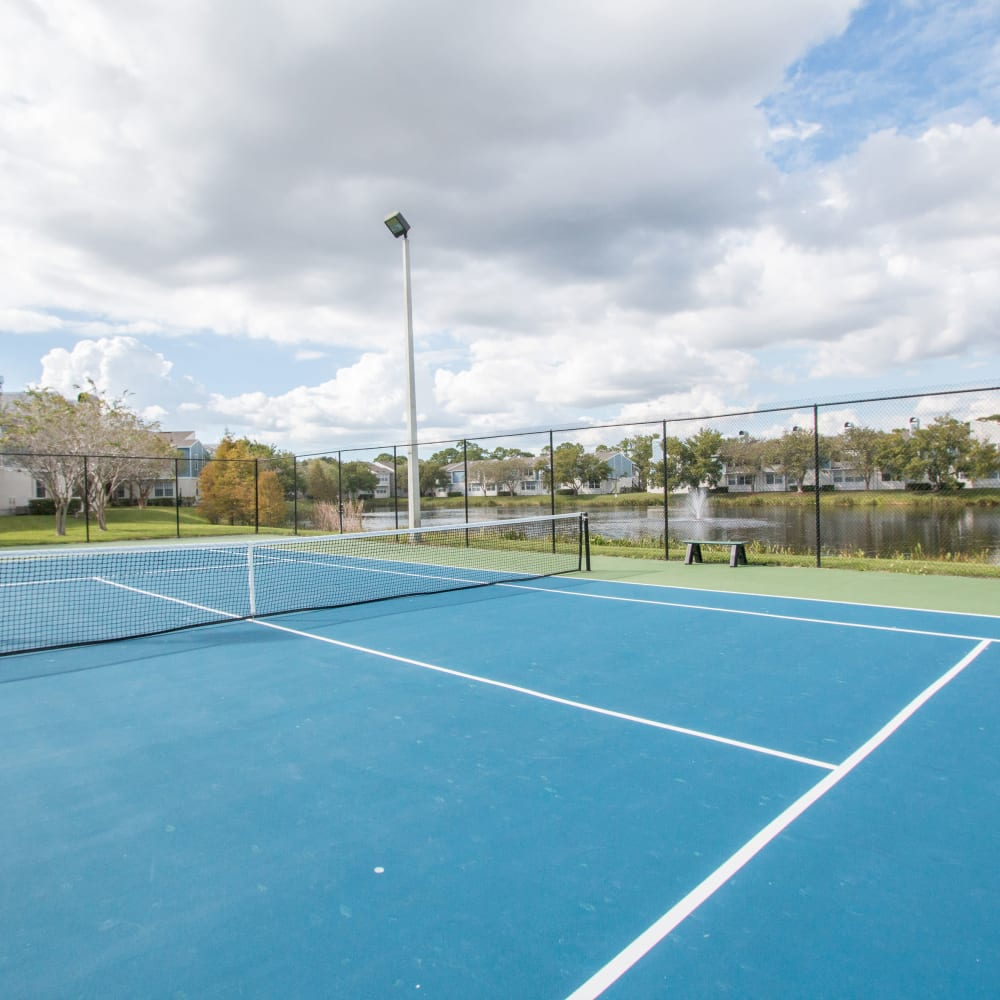 A large blue tennis court at Fairways at Feather Sound in Clearwater, FL