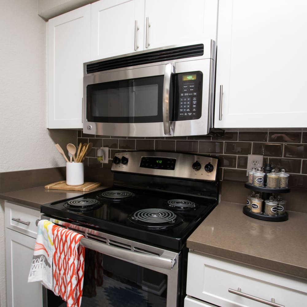 An apartment kitchen with new appliances at Fairways at Feather Sound in Clearwater, FL