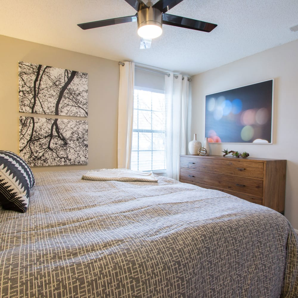 A large bed in an apartment at Fairways at Feather Sound in Clearwater, FL