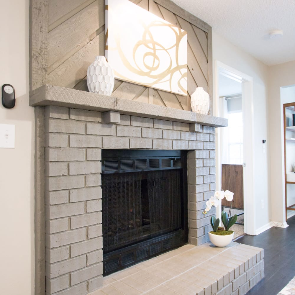 An apartment with a fireplace at Fairways at Feather Sound in Clearwater, FL