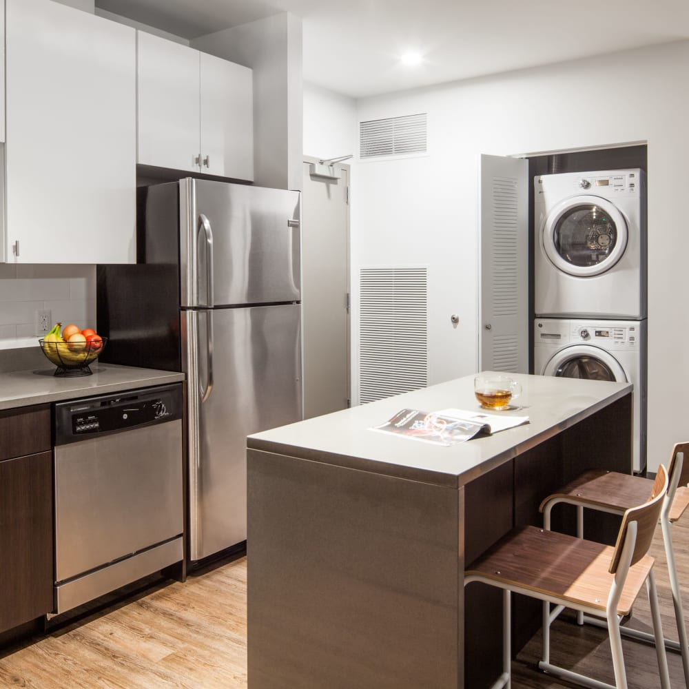 Kitchen with stainless steel appliances at LATITUDE in Lincoln, Nebraska