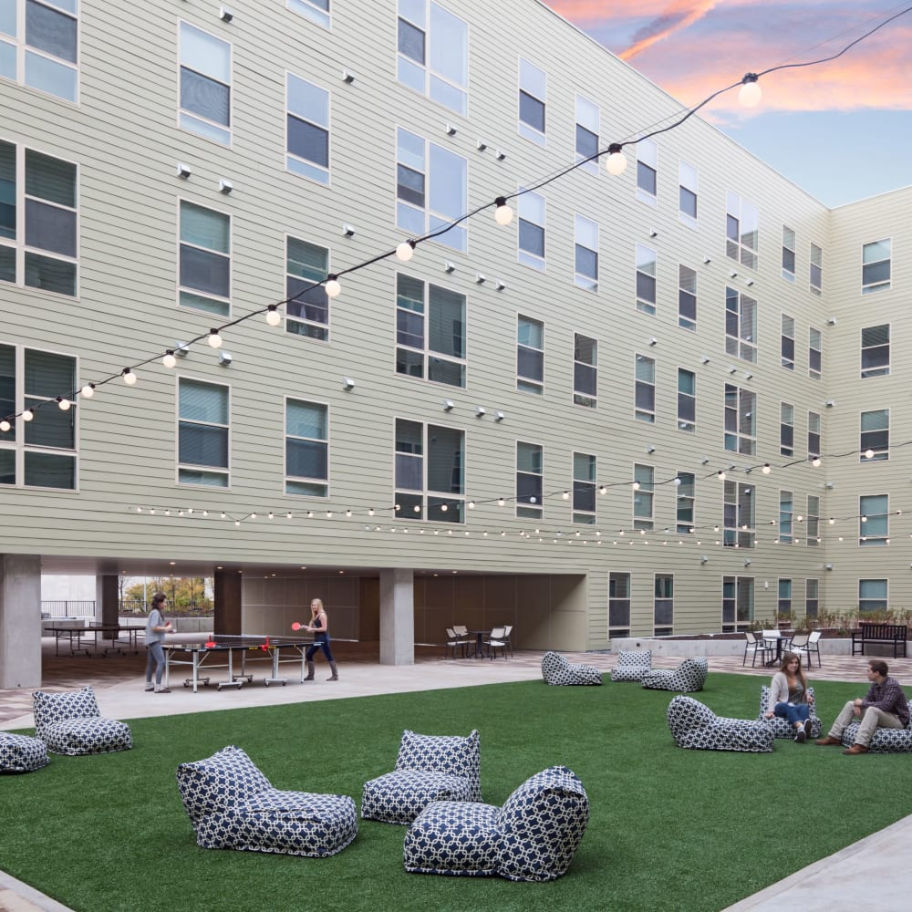 Lush outdoor courtyard lounge at LATITUDE in Lincoln, Nebraska