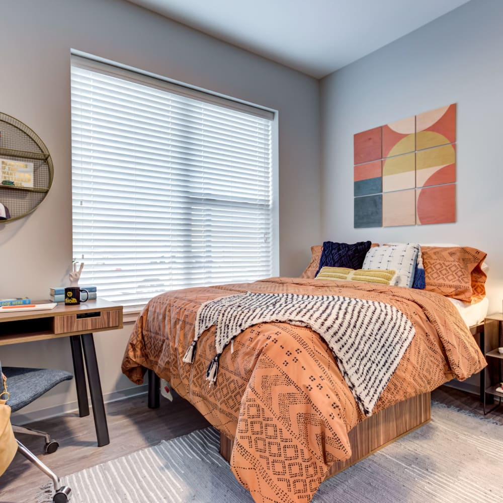 Cozy bedroom at LATITUDE at River Landing in Coralville, Iowa
