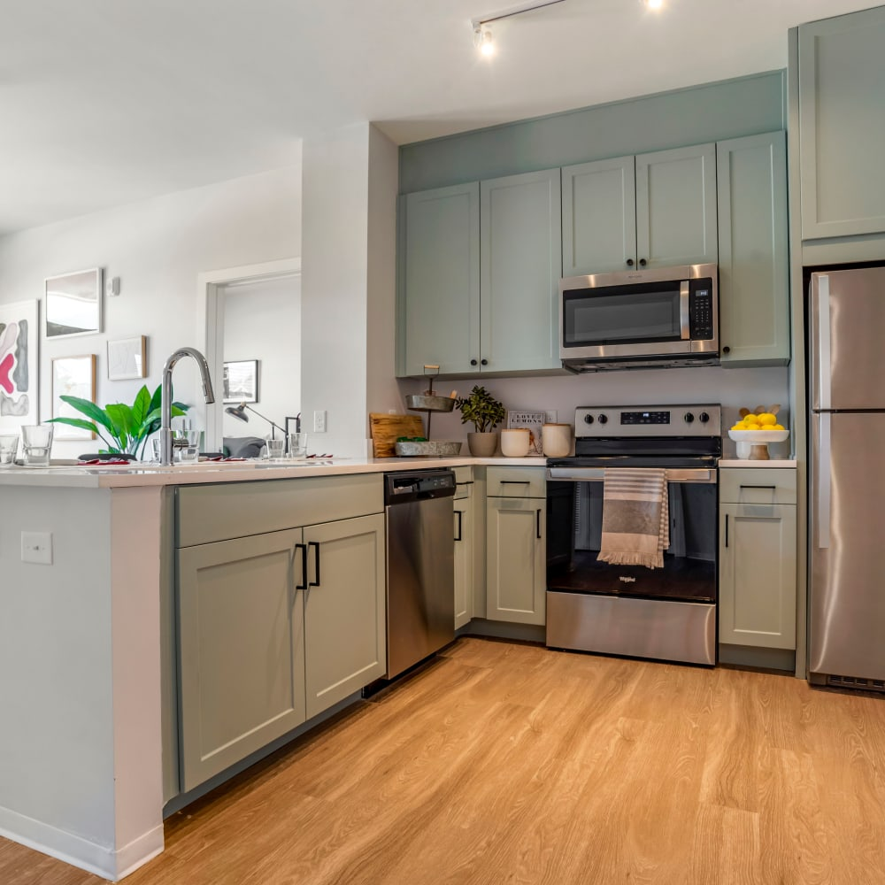 Kitchen with stainless steel appliances at UNCOMMON Tuscaloosa in Tuscaloosa Alabama