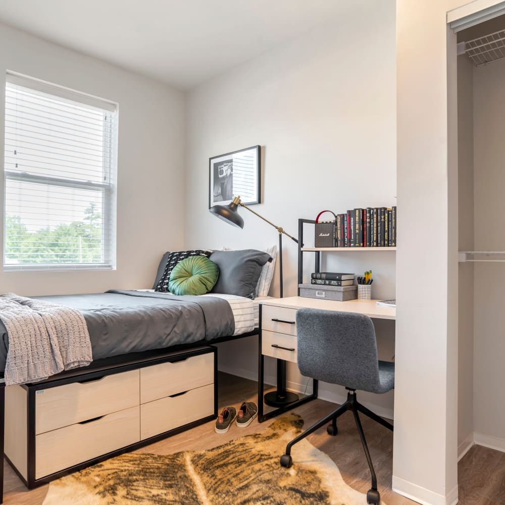 Cozy bedroom at UNCOMMON Tuscaloosa in Tuscaloosa, Alabama