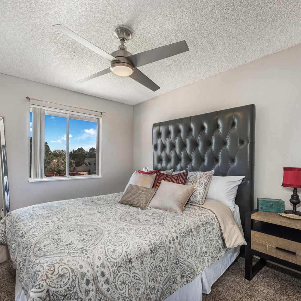 Bed in a model apartment home at Florida Station Apartments in Aurora, Colorado