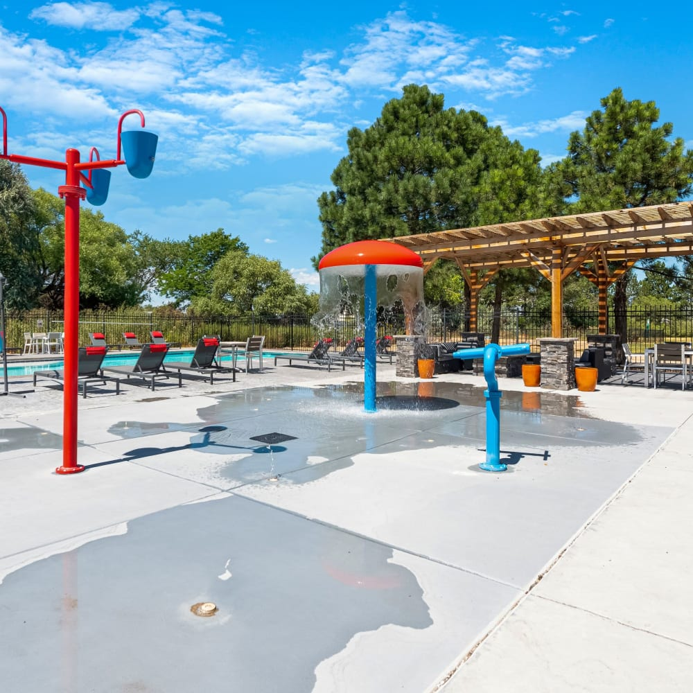 Sparkling pool with kids splash zone at Florida Station Apartments in Aurora, Colorado