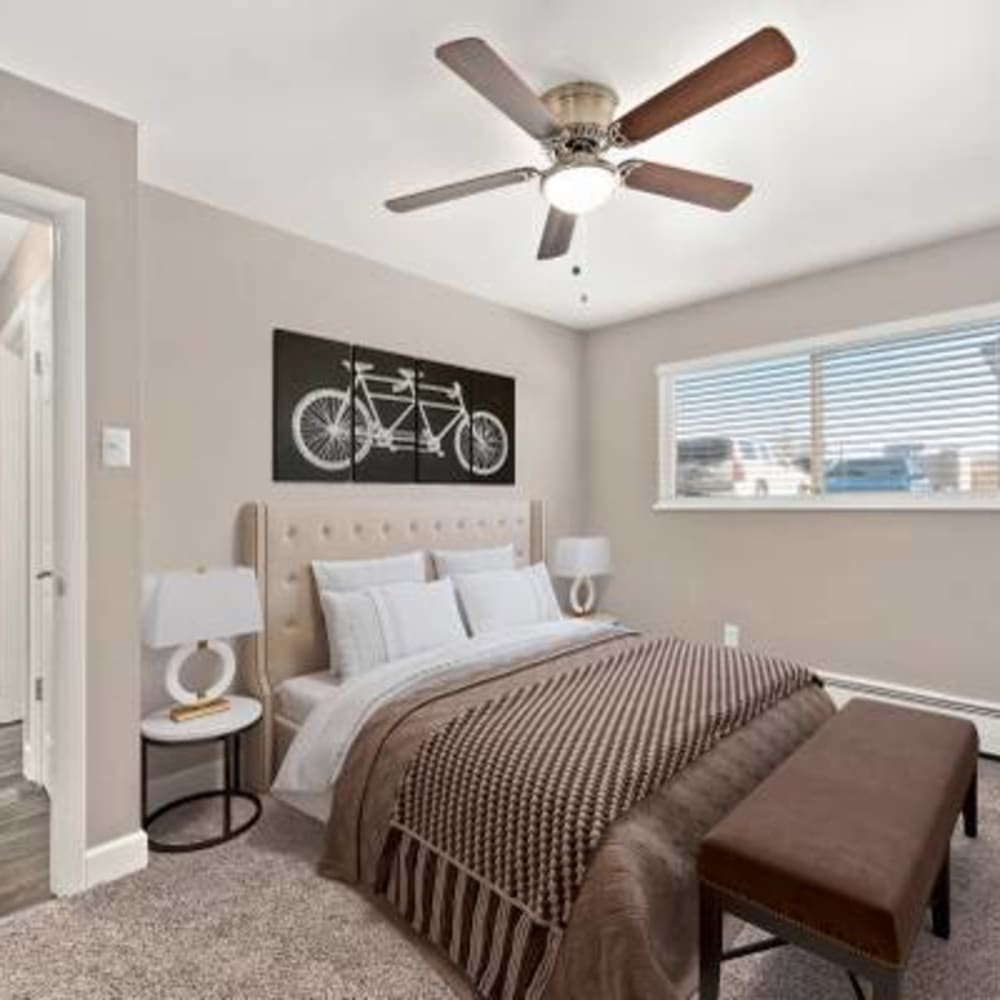 Spacious bedroom with large windows at The Phoenix in Brighton, Colorado