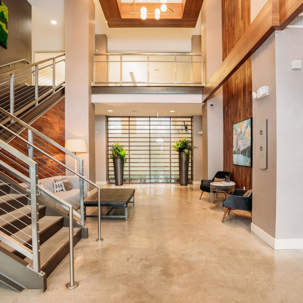 Marble flooring in the lobby with staircase leading to the mezzanine at Lakeshore Pearl in Austin, Texas