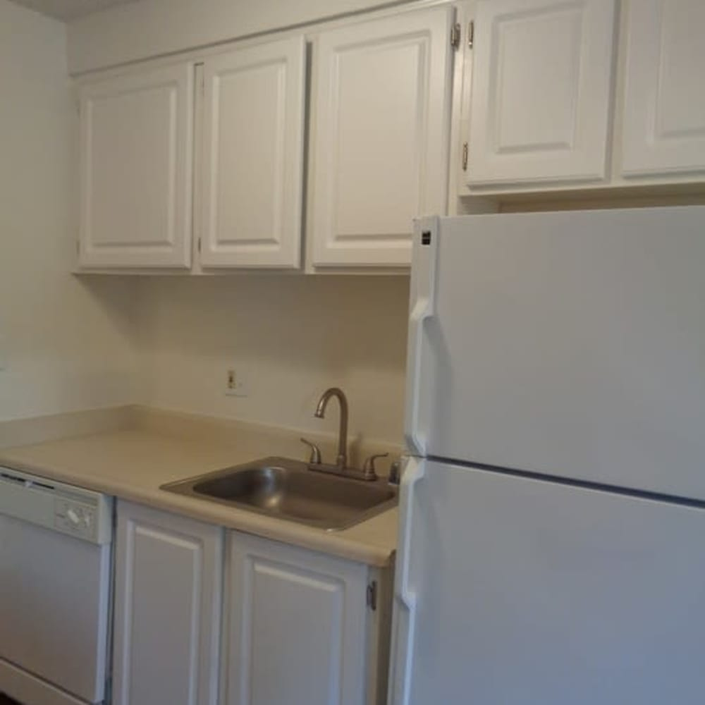 Sink and refrigerator in model apartment home at Amber Park in Sacramento, California