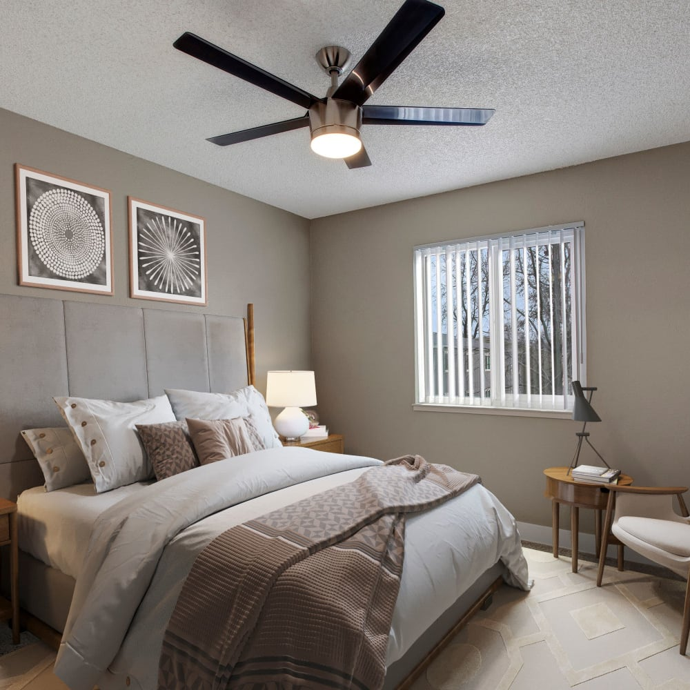 Bedroom with ceiling fan at The Hawthorne in Carmichael, California