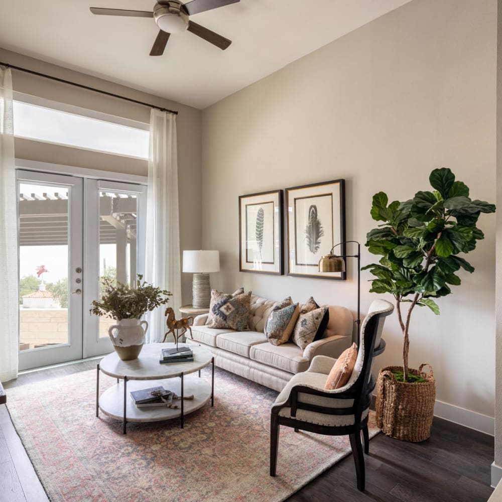 Ceiling fan and hardwood floors in the living area of a model home at Magnolia Heights in San Antonio, Texas