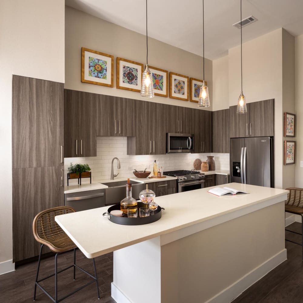 Quartz countertops and an island in a model home's kitchen at Magnolia Heights in San Antonio, Texas