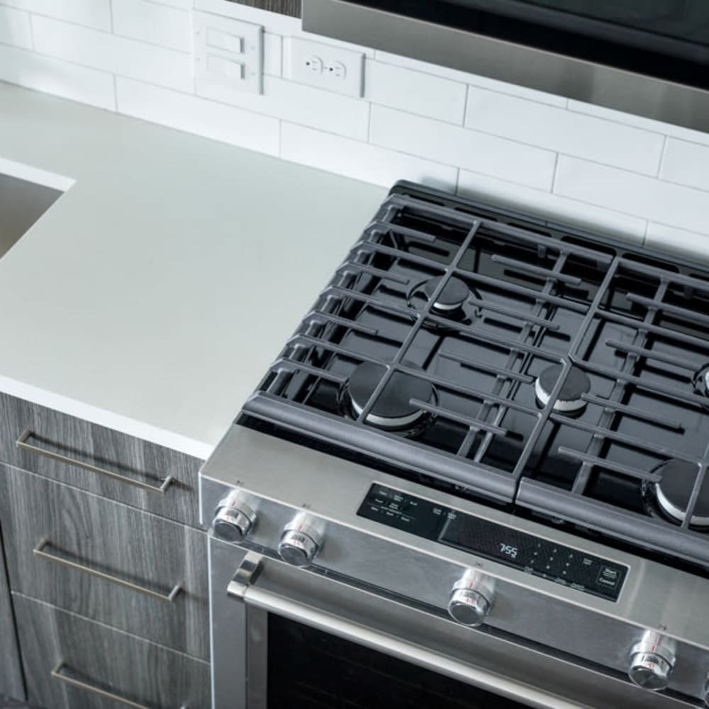 Gas range in a model apartment's kitchen at Magnolia Heights in San Antonio, Texas