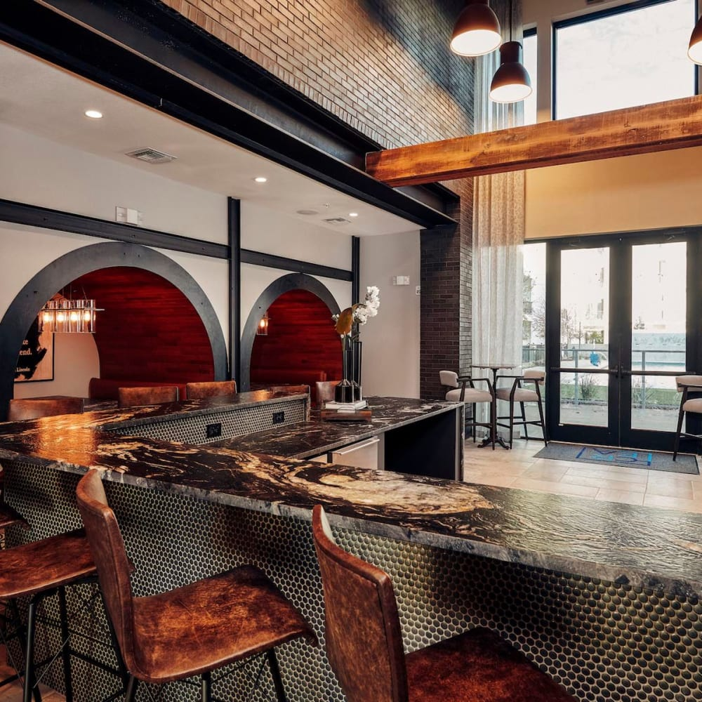 Bar seating at the resident clubhouse kitchen at The Guthrie in Austin, Texas