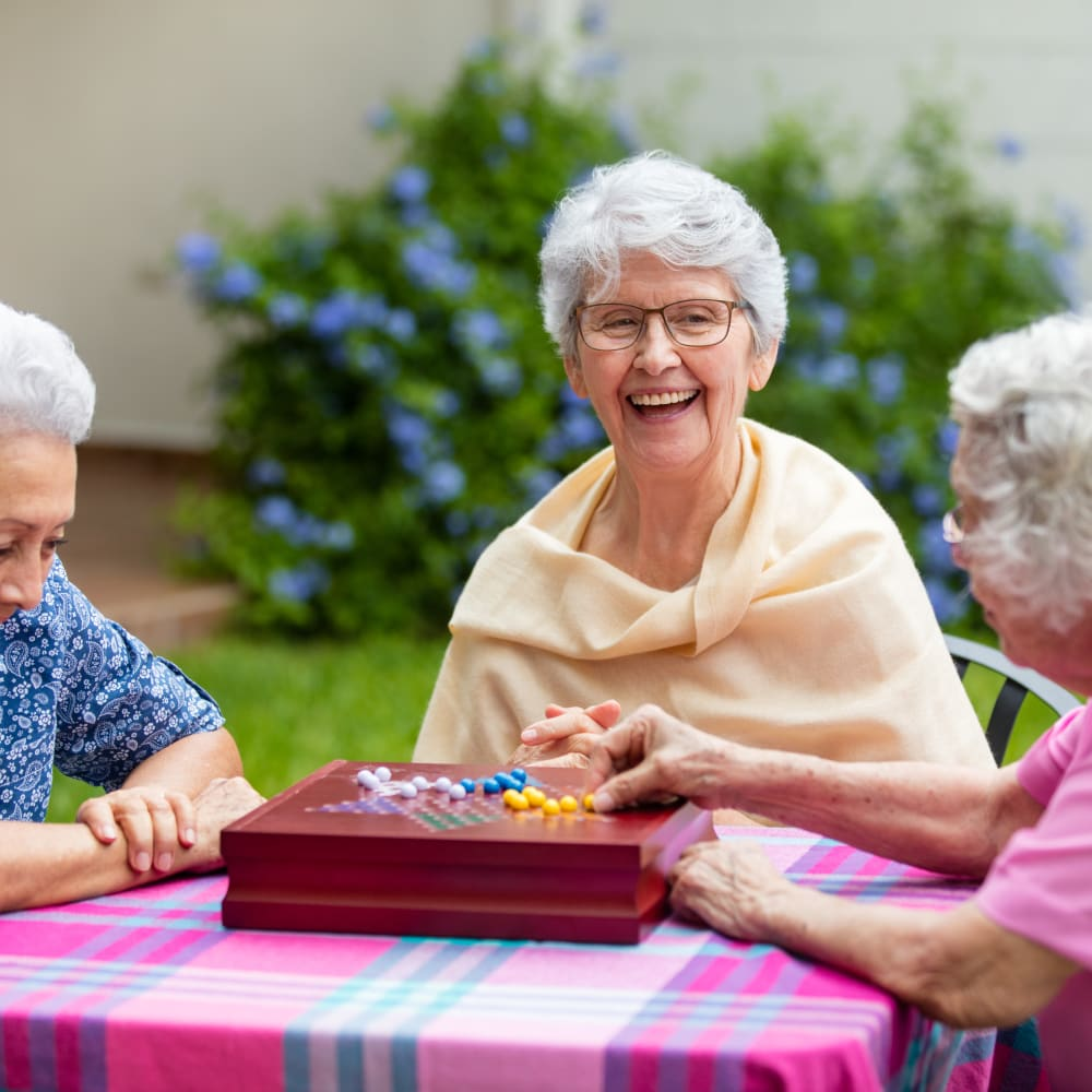 Residents playing a game together at Alura By Inspired Living in Rockledge, Florida