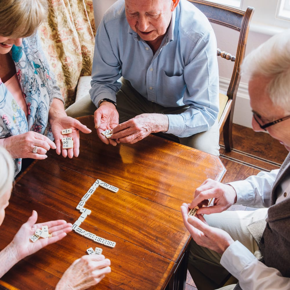 Residents playing Dominos at Alura By Inspired Living in Rockledge, Florida