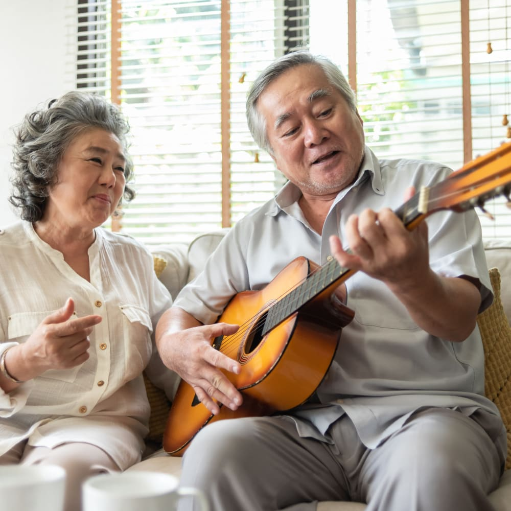 A resident playing the guitar at Alura By Inspired Living in Rockledge, Florida